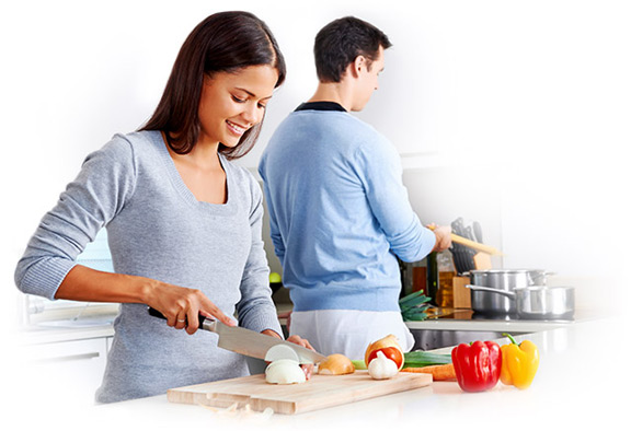 Man and woman working together to prepare a healthy meal
