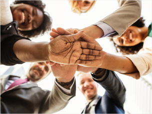 group of people with putting their hands together in teamwork
