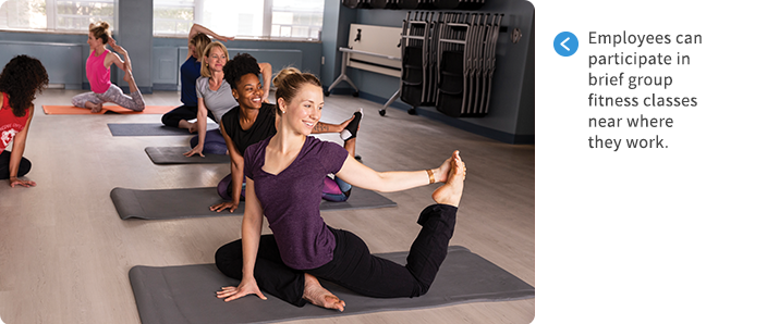 Employees participating in a yoga class