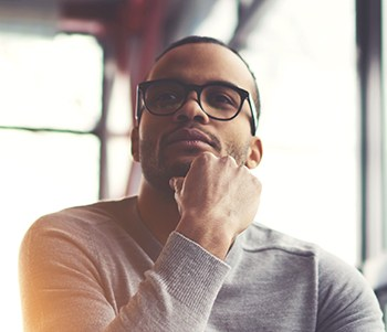 man thinking about the why of wellness